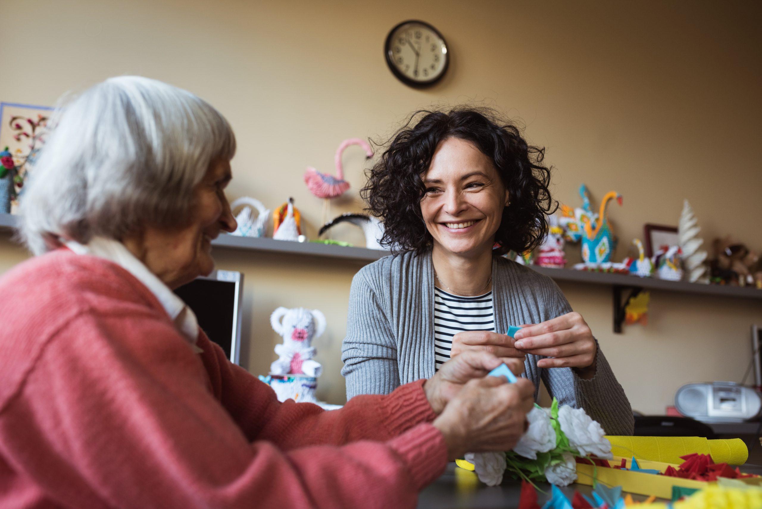senior-care-plus-cargiver-enjoying-moment-with-aged-women