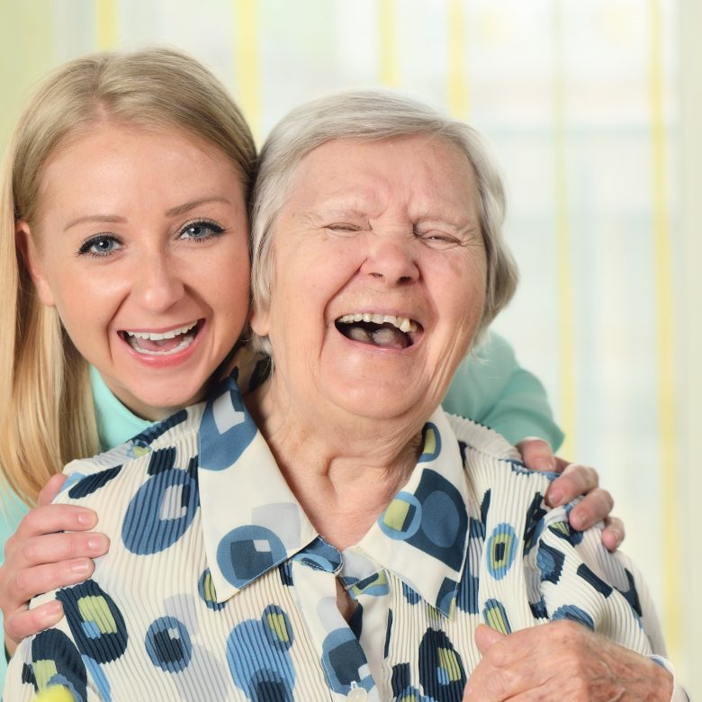 Senior woman with senior care plus caregiver. Happy and smiling.